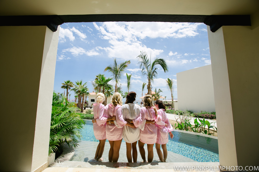 Bride and bridesmaids by the pool