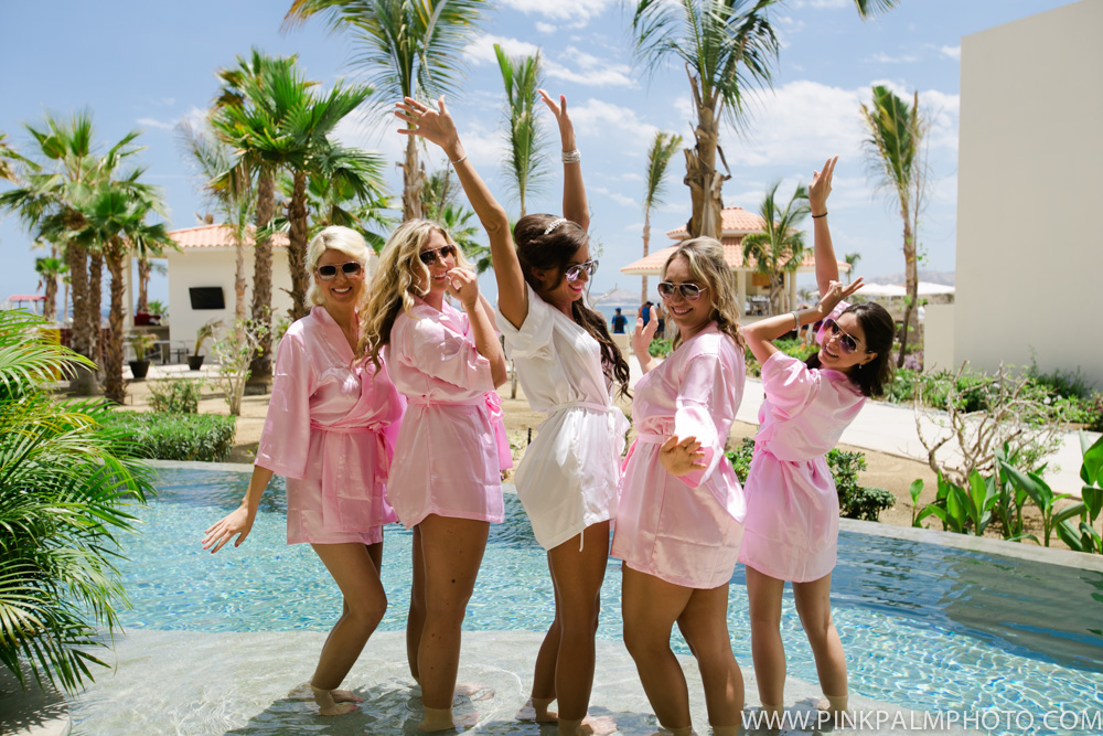 Happy beach bride and bridesmaids by the pool