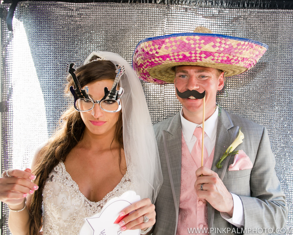 Bride and groom wearing funny accessories