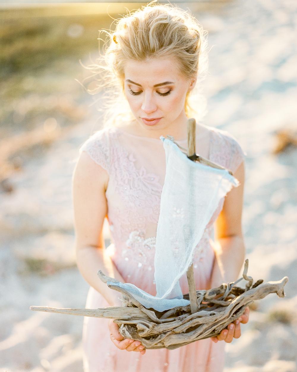 Bride holding decorative boat