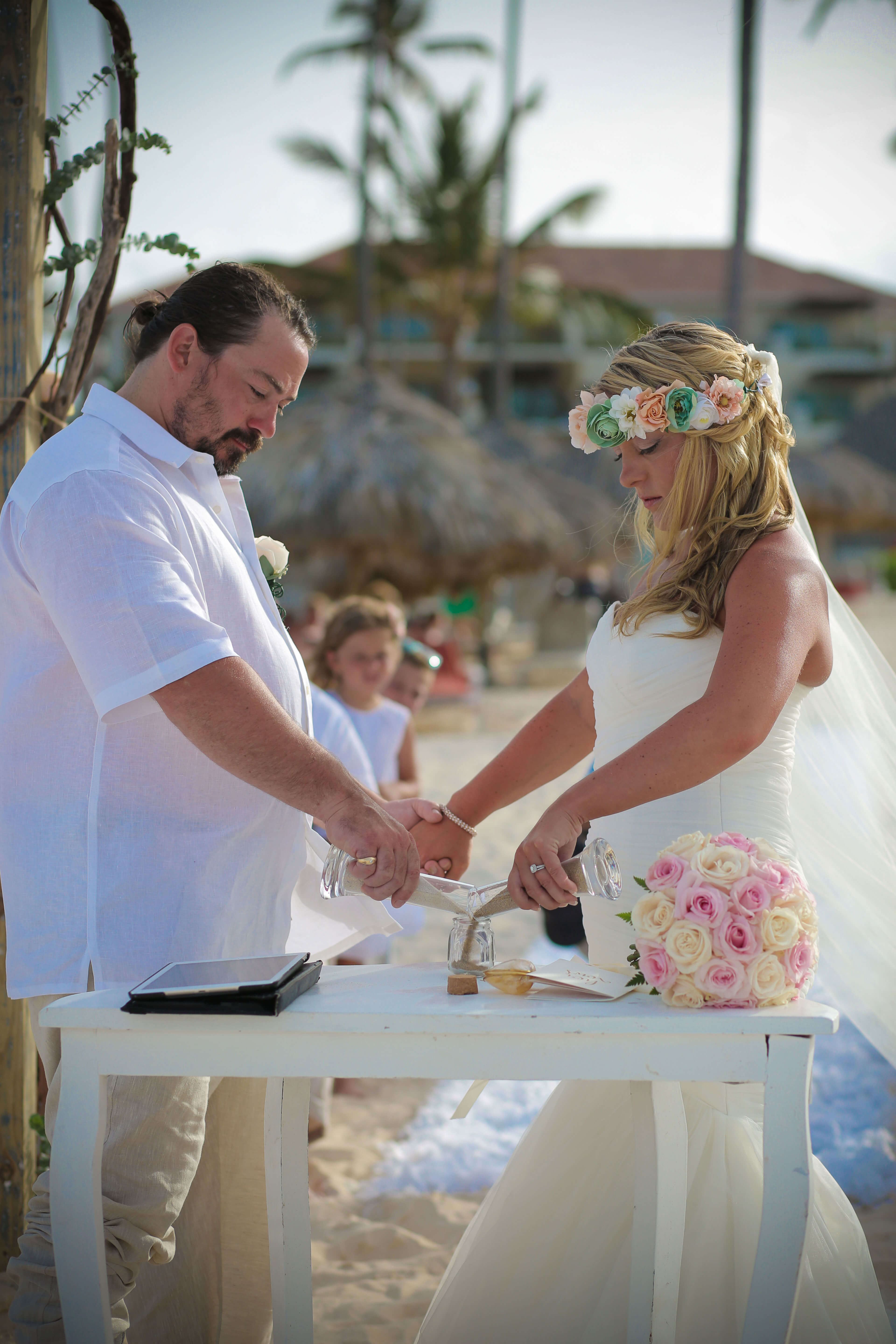 Bride and Groom Pouring Sand in Glass Vessel