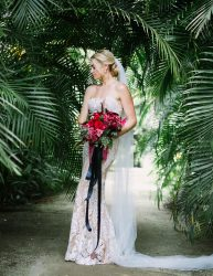 Gorgeous bride against tropical backdrop
