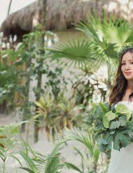 Bride among tropical greenery